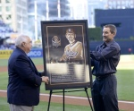 Ron Fowler and Peter Seidler unveil a replica of Hoffman's Padres Hall of Fame plaque
