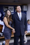 Traci and Trevor Hoffman watch the introduction video from the Padres dugout